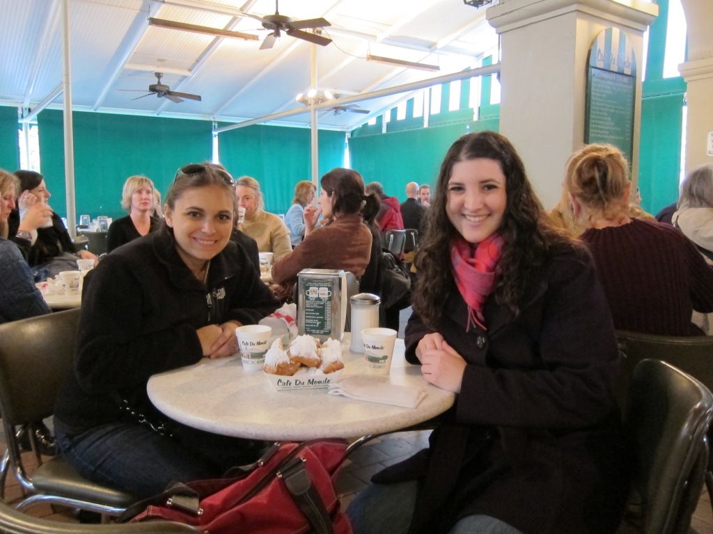Eating beignets at Cafe Du Monde in New Orleans with Anne